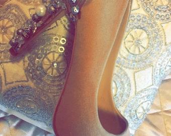 Silver heel shoe