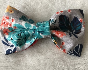 Gray bow with multi colored floral print