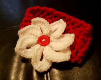 Red crocheted headband with flower and button