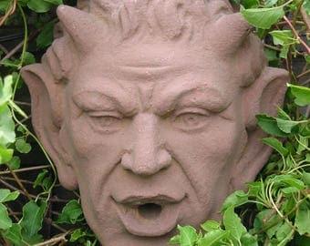 E 13 art antique sandstone look Devil head