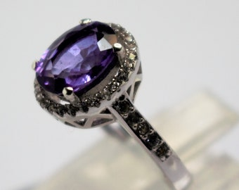White lap seam silver ring of amethyst and topaz
