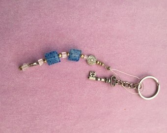 Charm - blue and clear beads and some silver