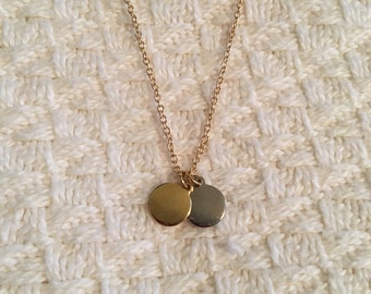 Gold and silver tone disc necklace ; matte gold chain