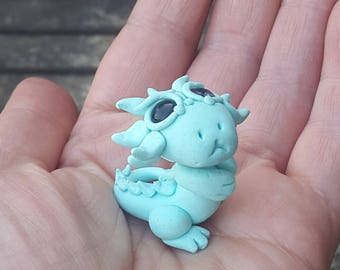Ultra miniature baby dragon, pastel mint green.