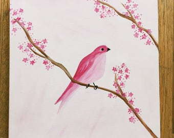 Painting of a pink bird and blossoms