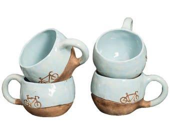 Ceramic mug with a bicycle motif
