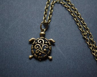 Bronze filigree tortoise necklace