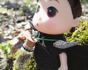 Small black Engel with spring trailer Dollhouse