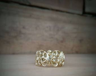 14K yellow gold scroll ring