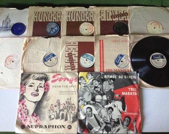 12 gramophone discs + others