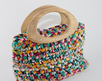 Colorful hand bag from textile yarn