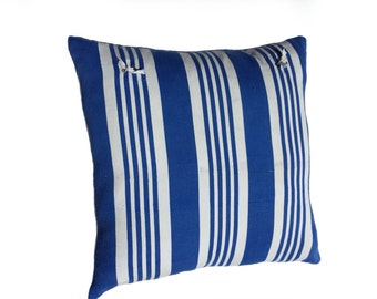Square cushion cover made of vintage fabric with blue stripes