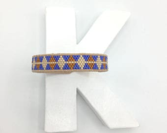 Woven bracelet bright blue / Brown and leather lace