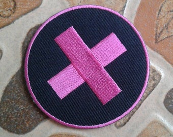 Pink cross patch.