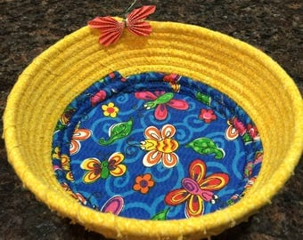 Handmade basket with butterly pattern.