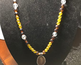 Natural Stone Pendant with faceted beads in hues of brown and amber.