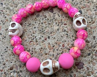 Beaded Bracelet - Pink Beads with Three White Skull Beads