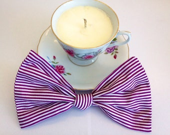 Large purple striped bow with clip.