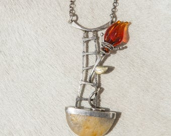Surrealist necklace in silver and gold