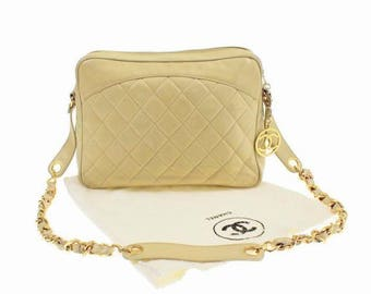 Authentic vintage Chanel shoulder bag with gold metal chain