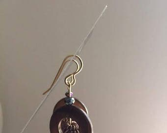 Brass earrings with beads.