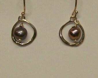 Pearls framed in silver-drop earrings