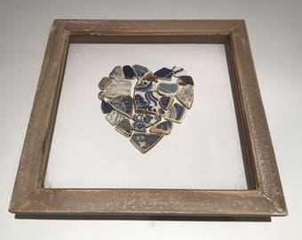 White and blue beach pottery heart.