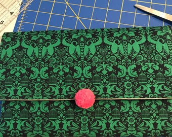 Green damask with pinky puff clutch