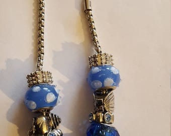 Blue spotted beads with charms.