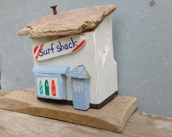 Cornish seaside surf shop made from driftwood from Solent beaches