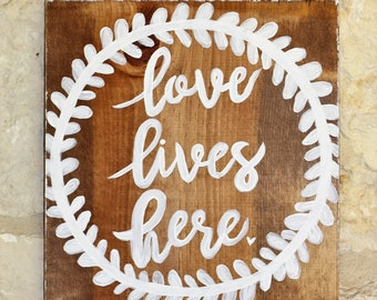 12X12 Love Lives Here Wood Sign, Hand Painted.