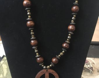 Brown and gold peace necklace and earrings