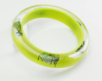 Beautiful chartreuse salad green lucite bangle with real iridescent beetles