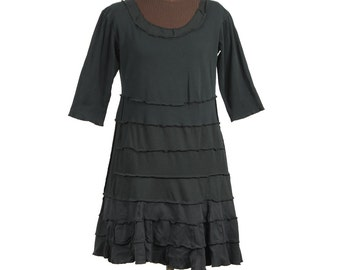 black upcycled dress with scooped neckline, elbow-length sleeves