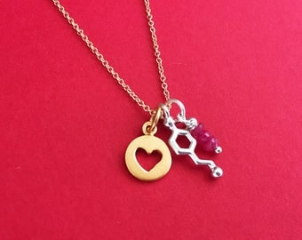 tiny dopamine heart ruby charm necklace in sterling silver and gold plate