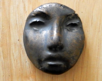 stoneware face number five
