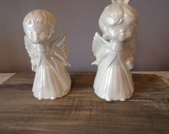 Pair of large iridesent Christmas angels, boy and girl, holiday decoration