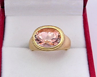 AAAA Salmon Peach Morganite Top Color   11x8mm  3.32 Carats   in Ladies 18K Yellow gold cocktail ring 10 grams. 2609