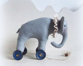 Little circus elephant on vintage blue Meccano wheels