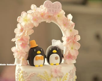 Penguins with swarovski crystal flower wedding cake topper