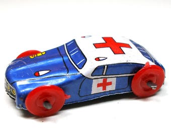 60s Tin Toy car, Vintage blue ambulance, emergency vehicle. Japanese tin lithograph.