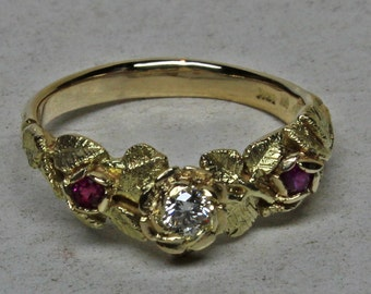 Rose ring in 18K gold with rubies and a diamond, size 6