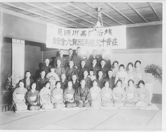 Vintage black and white photo of a group of Japanese  men and women