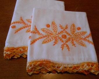 Set of vintage crocheted peach pillowcases
