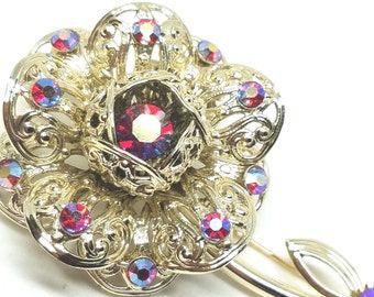Sarah Coventry Fashion Flower Pin with red aurora borealis rhinestones