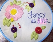 Hand embroidered hoop art fancy and fuck