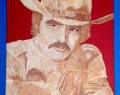 Burt Reynolds portrait in rice straw art.  Handmade with thousands of tiny pieces of rice leaves! Only one made. Unique leaf art collectibl