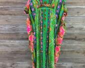 1960's groovy barkcloth Hawaiian print maxidress/moo moo. Size: OSFM