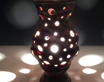 Red yellow and black lamp with circle cutouts