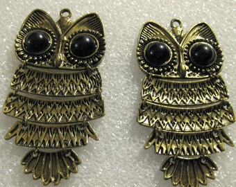 Two Brass Articulated Owl Pendants